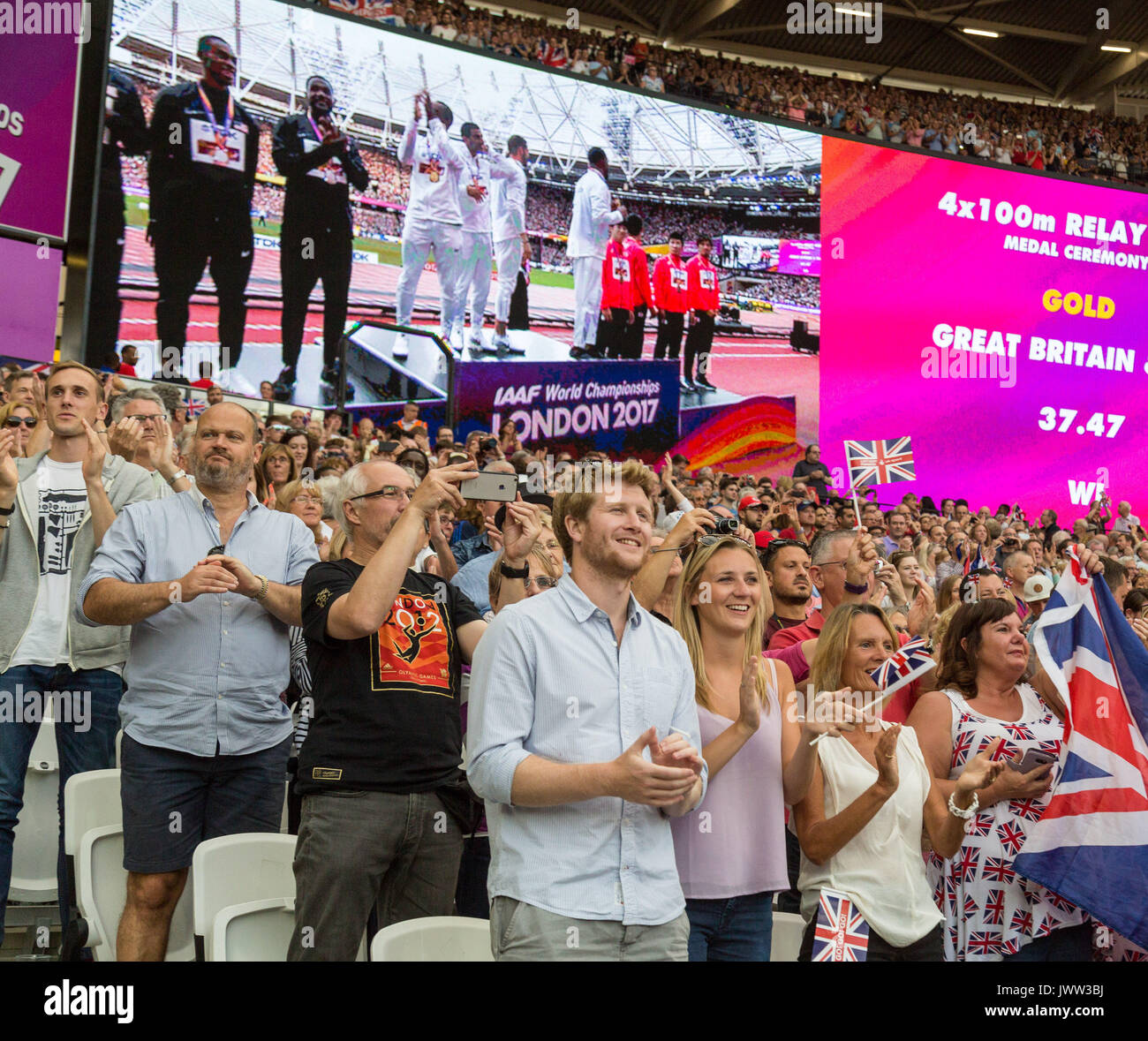 London, UK. 13th Aug, 2017. London, August 13 2017 . Fans cheer the British 4x100 team as they arrive for their gold medal ceremony on day ten of the IAAF London 2017 world Championships at the London Stadium. Credit: Paul Davey/Alamy Live News - Stock Image