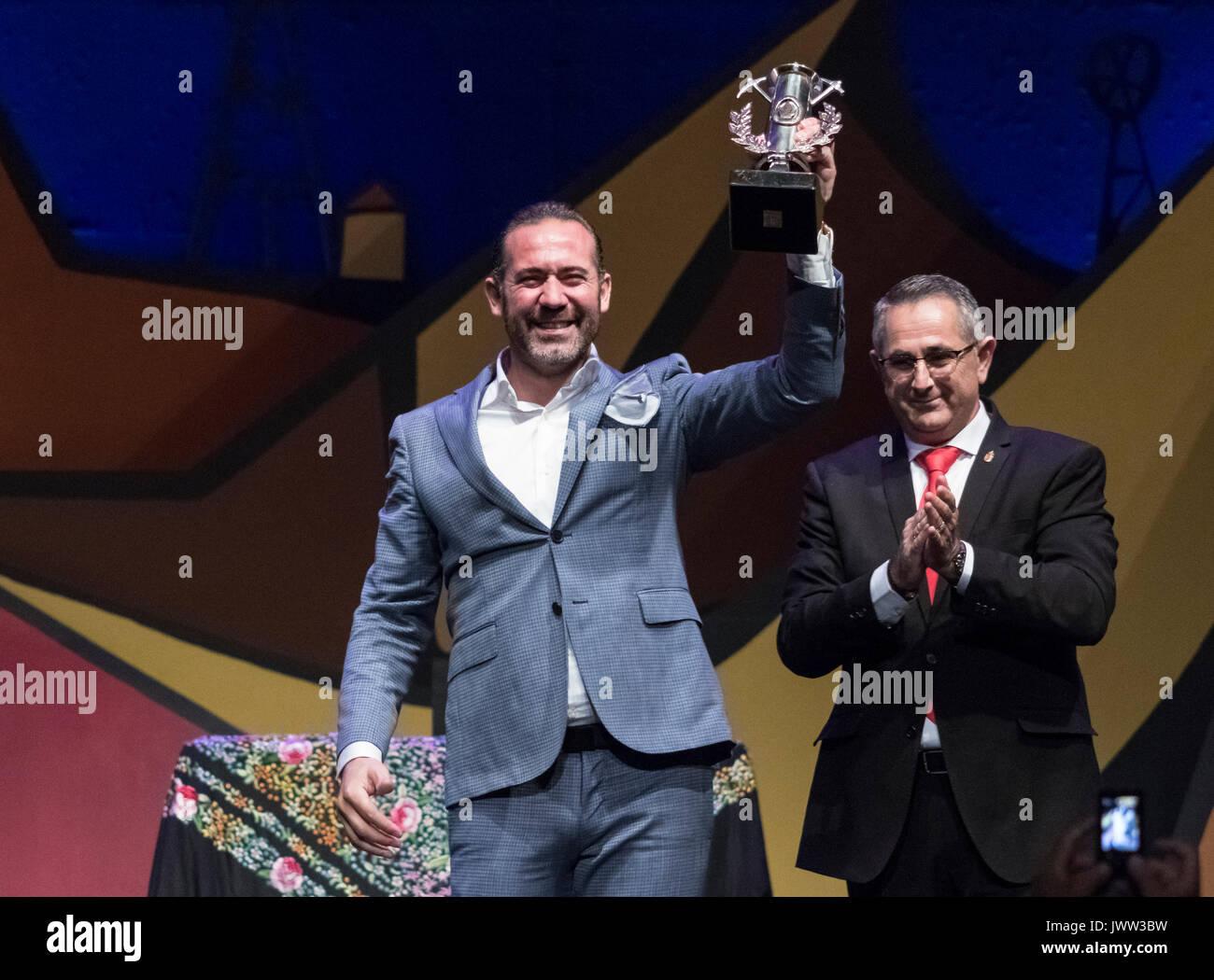La Unión, Spain. 12th August, 2017. Flamenco singer, Alfredo Tejada Zurita, wins the Lampara Minera trophy at the final of the 'Cante de las Minas' International Flamenco Festival. Credit: ABEL F. ROS/Alamy Live News - Stock Image