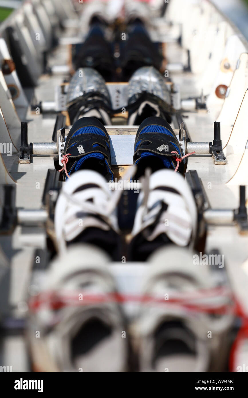 Peterborough, Cambridgeshire UK. 13th August, 2017. Shoes in a rowing boat at the Peterborough Rowing Club Summer Regatta, Peterborough, Cambridgeshire UK on August 13, 2017 Credit: Paul Marriott/Alamy Live News - Stock Image
