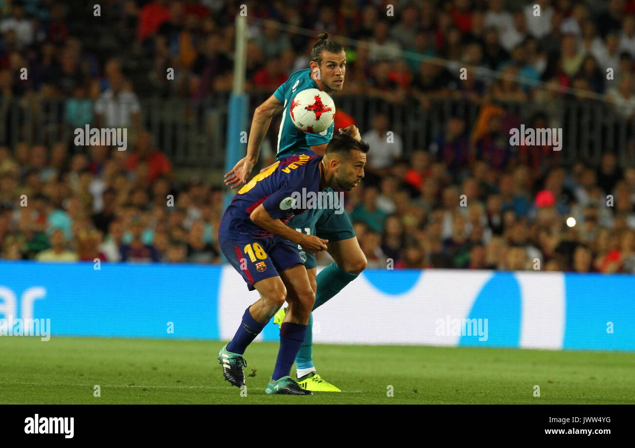 Bale in action during Supercopa de Espa–a game 1 between FC Barcelona against Real Madrid at Camp Nou - Stock Image