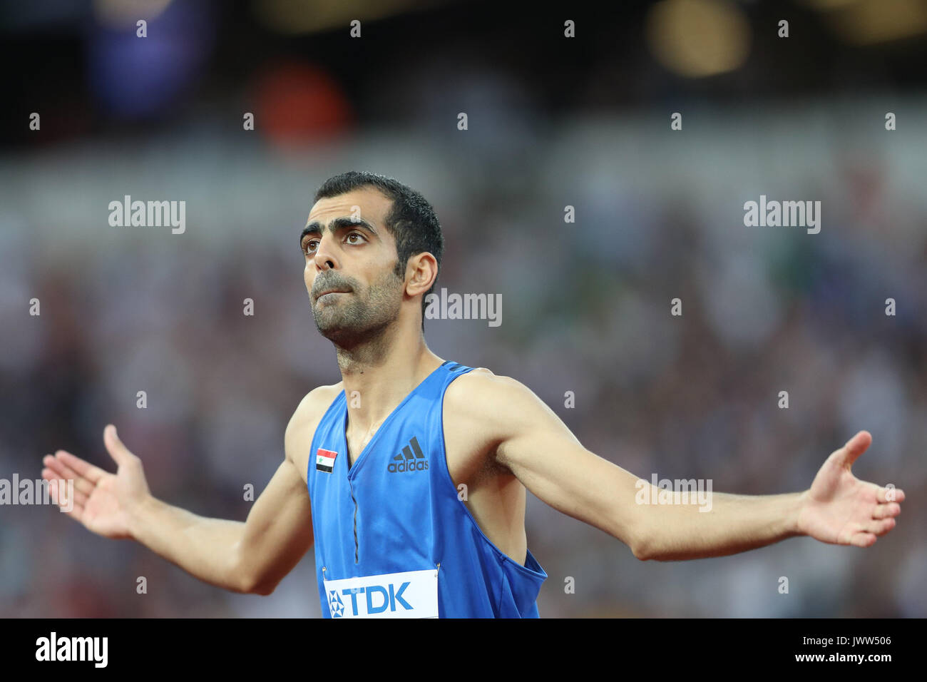 London, UK. 13th Aug, 2017.  Majd Eddin Ghazal, Syria, asks the crowd to clap as he prepares to jump in the men's high jump final on day ten of the IAAF London 2017 world Championships at the London Stadium. Credit: Paul Davey/Alamy Live News - Stock Image