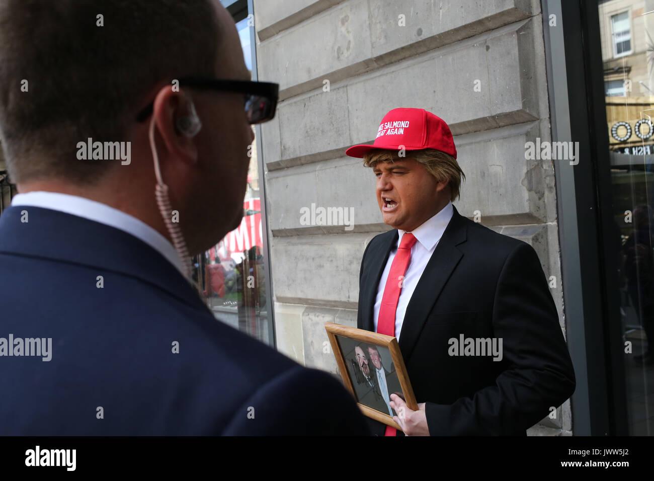 Edinburgh, Scotland, UK. 13th Aug, 2017. 'Donald Trump' (Danny Posthill an Impressionist) waits outside the Assembly Stock Photo