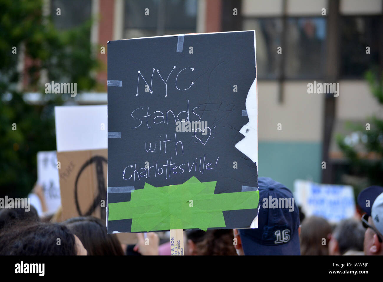 Charlottesville, USA. 13th Aug, 2017. People gathered in Union Square to denounce President Trump and the neo-nazi Stock Photo