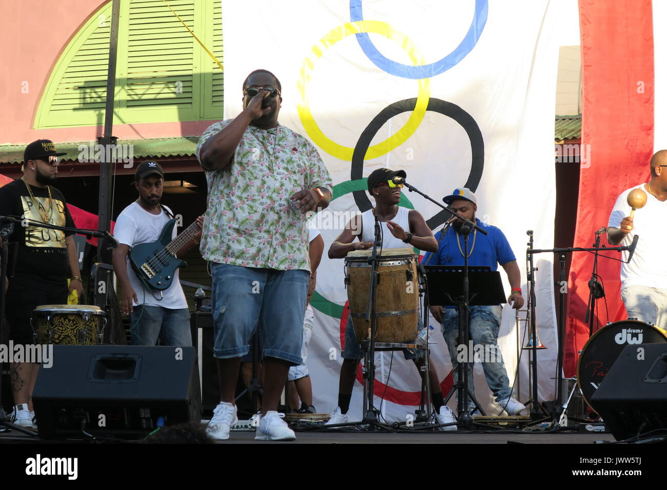 Hiram Abrante, leader of the music band La Tribu de Abrante, sings during the first anniversary of the olympic gold won by tennis player Monica Puig, at the Placita de Santurce in San Juan, Puerto Rico, 13 August 2017. Puig was the first gold olympic medalist of the island's history. EFE/Jorge Muniz - Stock Image