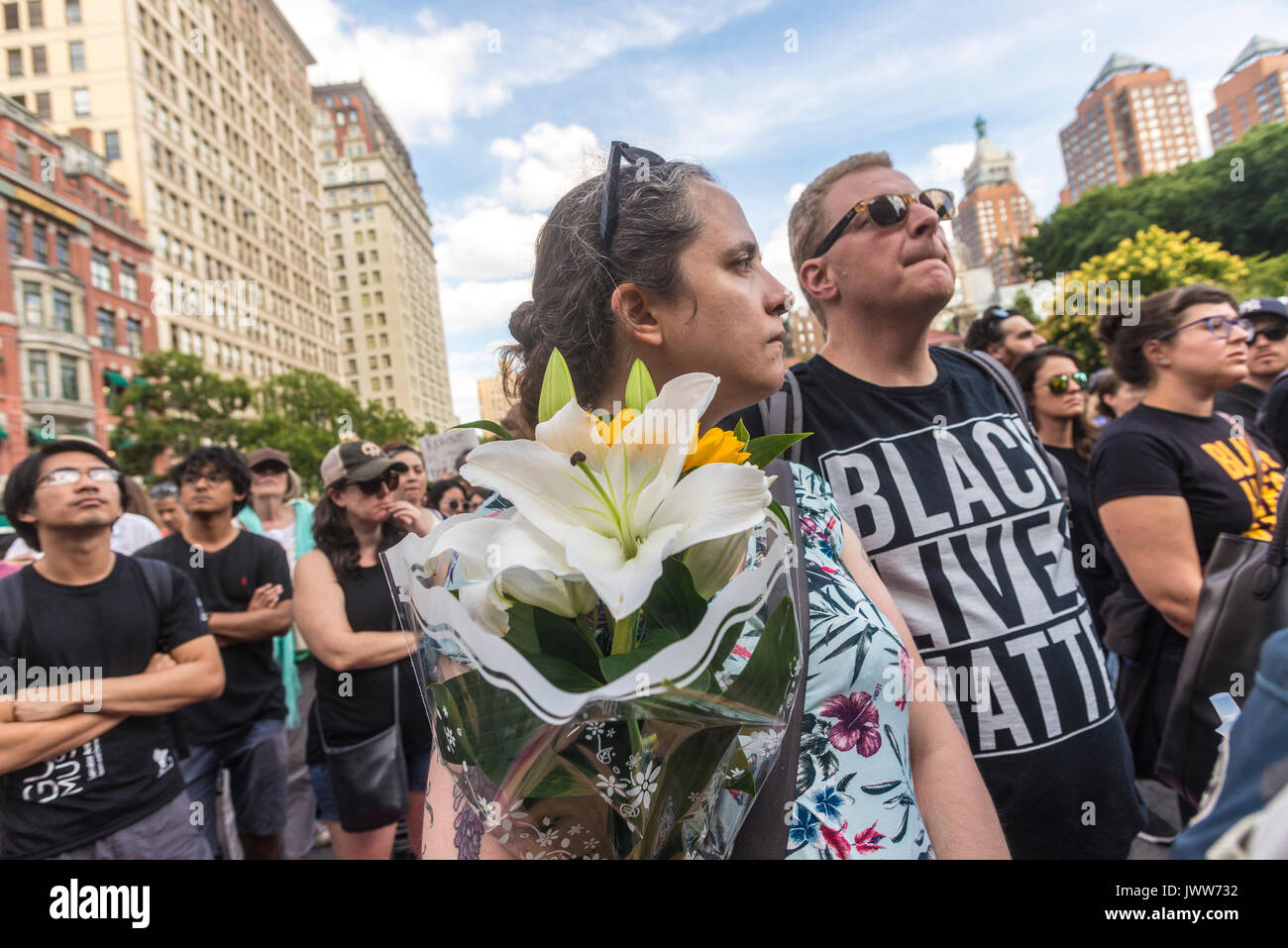 New York, NY, USA. 13th Aug, 2017. New Yorkers gathered in Union Square to stand in solidarity with the people of Charlottesville, VA, condemn the Alt Right, fascism, and President Donald Trump, after three people were killed in connection with a right wing rally called 'Unite the right.' The crowd included activists from Democratic Socialists, Black Lives Matter, the ACLU and other groups. CREDIT: Credit: Stacy Walsh Rosenstock/Alamy Live News - Stock Image