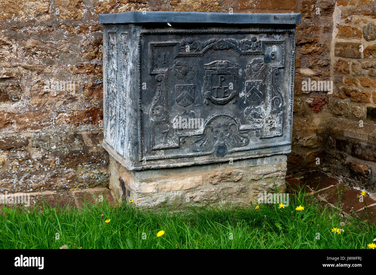 17th century lead trough outside St. Martin`s Church, Welton, Northamptonshire, England, UK - Stock Image