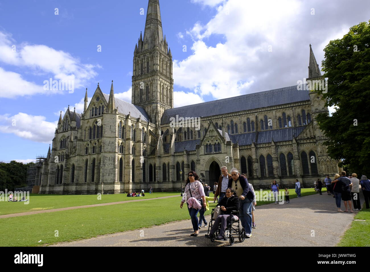 Family with disabled member visiting Salisbury Cathedral, Wiltshire,UK - Stock Image