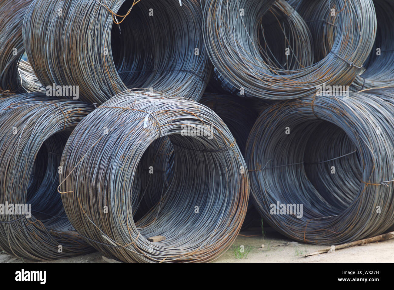 Thin metal reinforcement with corrugation wound into bays at the metal products warehouse, Russia Stock Photo