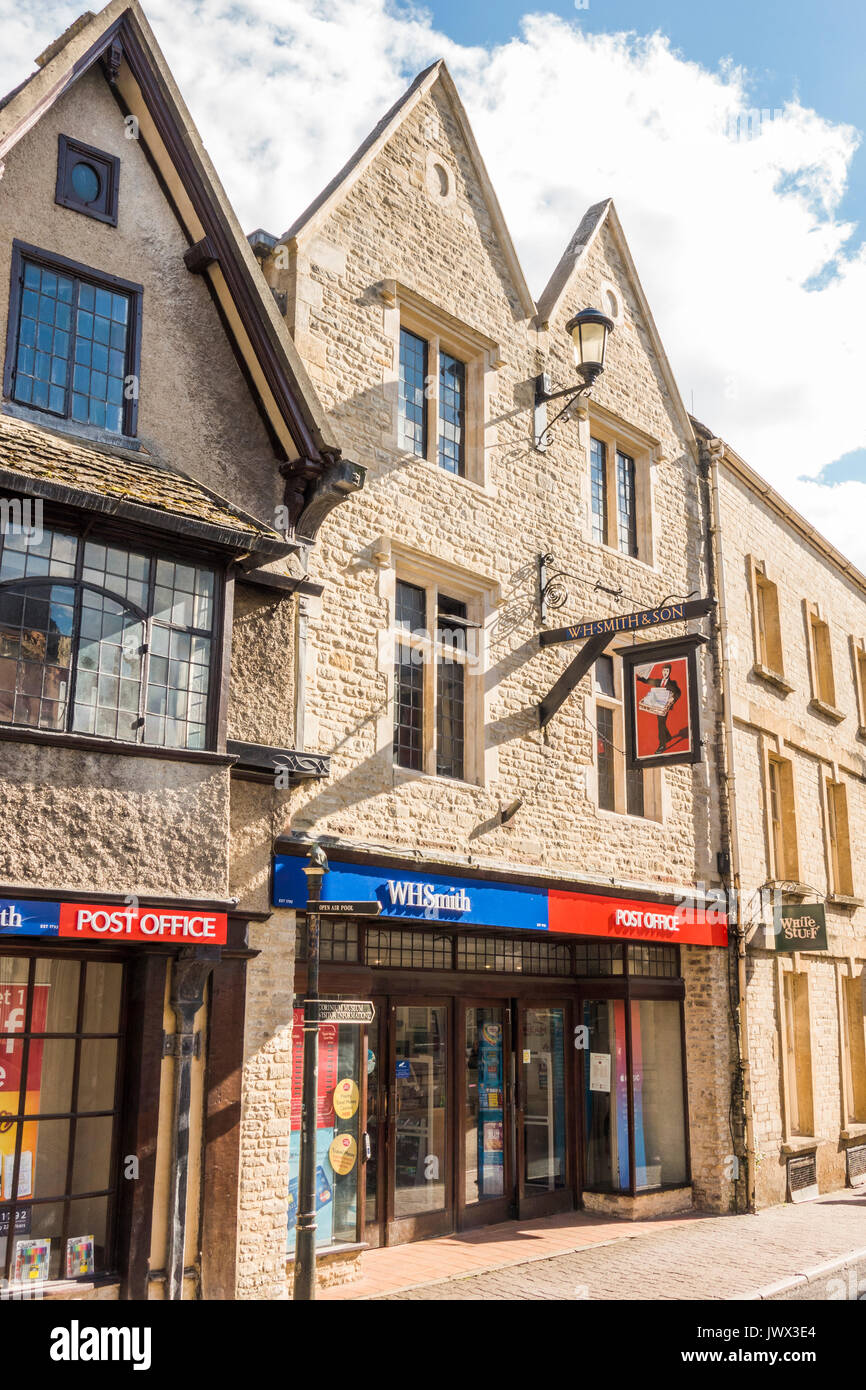 Shop / store branch of WH Smith and Post Office in period buildings, in the centre of the Cotswolds town of Cirencester, Gloucestershire, England, UK. - Stock Image