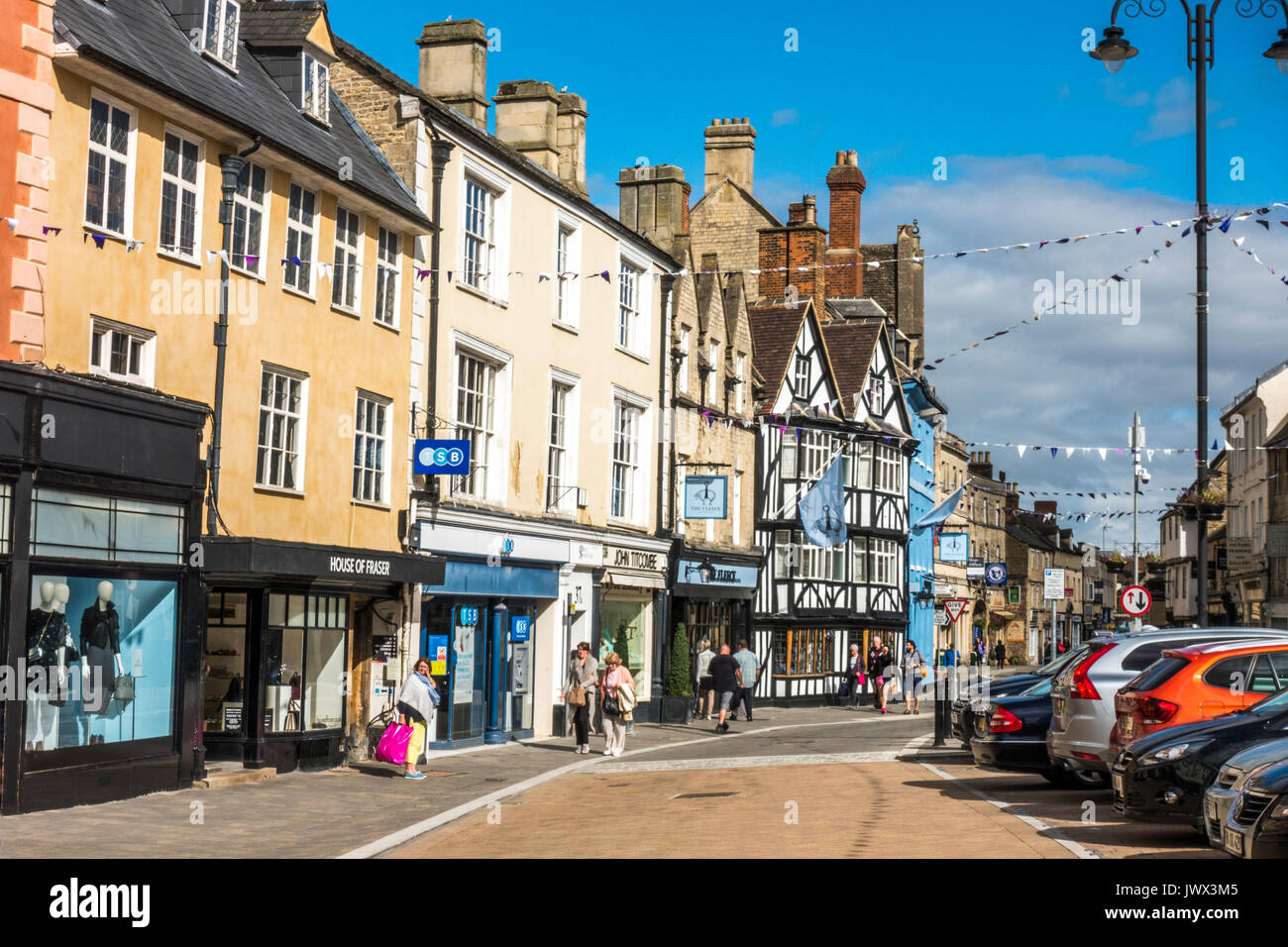 Shops and shoppers in the centre of the Cotswolds town of Cirencester, Gloucestershire, England, UK. Stock Photo