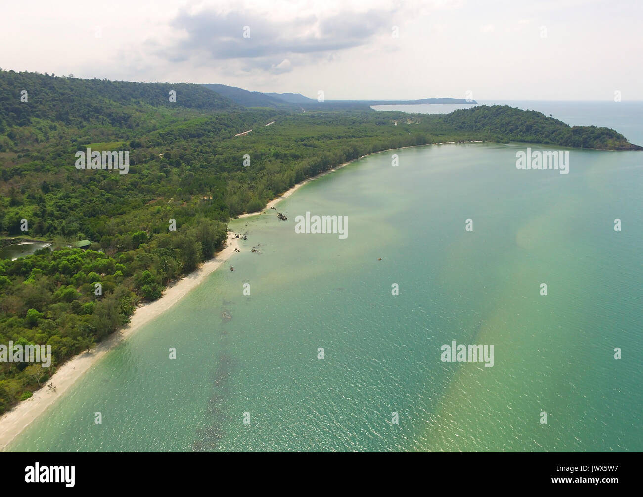 Aerial bird's eye view of emerald green placid sea and the Gulf of Thailand's coast by drone - Stock Image