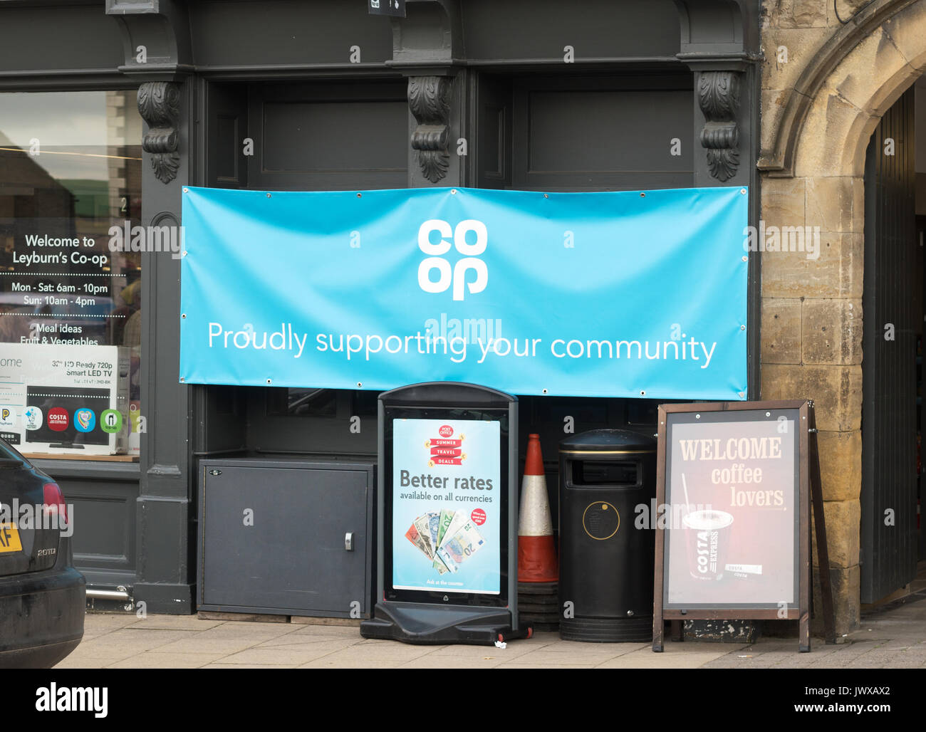 Co-op sign, Proudly supporting your community, Leyburn, Wensleydale, North Yorkshire, England, UK - Stock Image