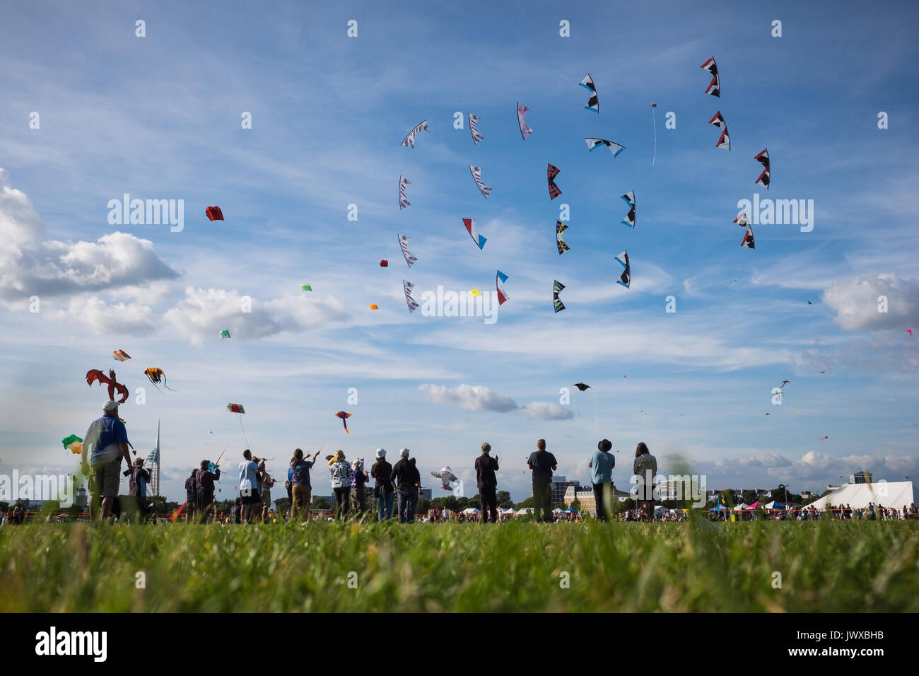 People at the Portsmouth International Kite Festival 2017, on what was the 26th anniversary for the festival held on Southsea Common - Stock Image