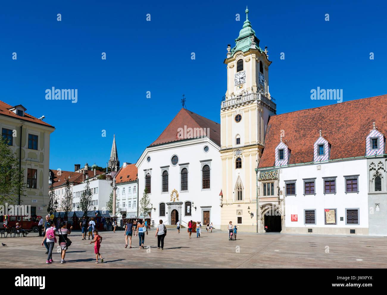 Holy Saviour Church (Jesuit Church) and Old Town Hall on Hlavné námestie (Main Square), Old Town, Bratislava, Slovakia - Stock Image