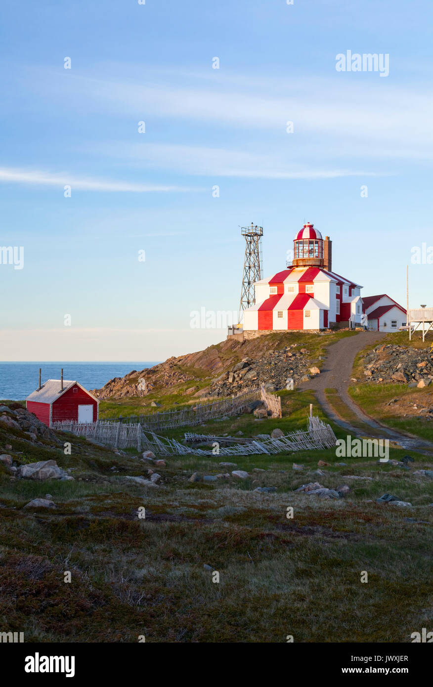 The Cape Bonavista Lighthouse seen here at sunset was in operation from 1842-1962. It is now a museum and is a Provincial Historic Site. - Stock Image