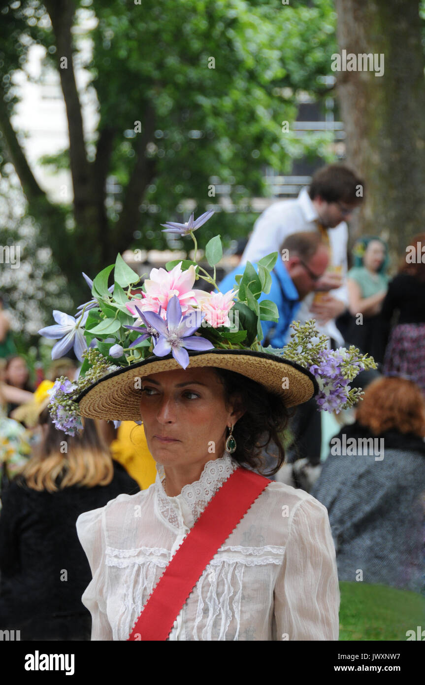 A woman is dressed as a suffragette, at the 2017 Chap Olympiad, London. - Stock Image