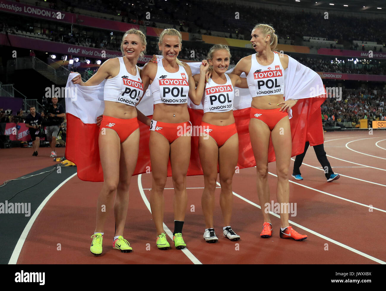 Poland Women's 4x400m relay final team (left to right) Alekandra Gaworska, Justyna Swiety, Malgorzata Holub and Iga Baumgart celebrate winning bronze during day ten of the 2017 IAAF World Championships at the London Stadium. PRESS ASSOCIATION Photo. Picture date: Sunday August 13, 2017. See PA story ATHLETICS World. Photo credit should read: Adam Davy/PA Wire. RESTRICTIONS: Editorial use only. No transmission of sound or moving images and no video simulation. - Stock Image