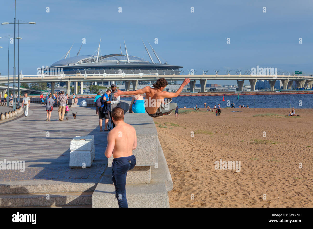 St. Petersburg, Russia - August 1, 2017: Park 300th anniversary of St. Petersburg, young man practicing parkour in the city park. - Stock Image