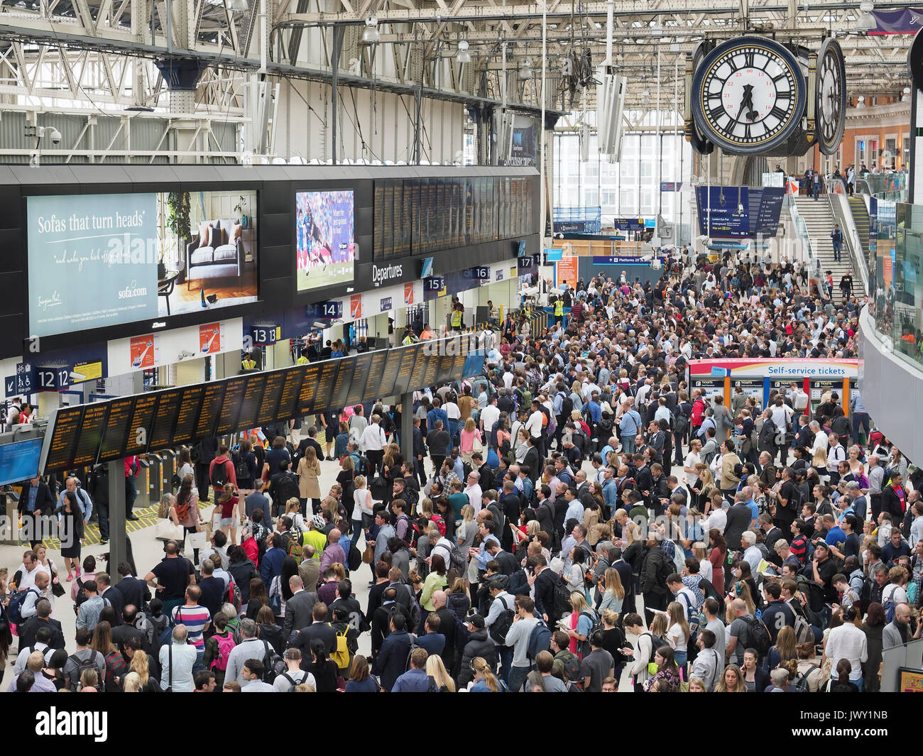 A view looking down on the crowded concourse at Waterloo Station in London due to platform closures during the 2017 station engineering upgrade - Stock Image