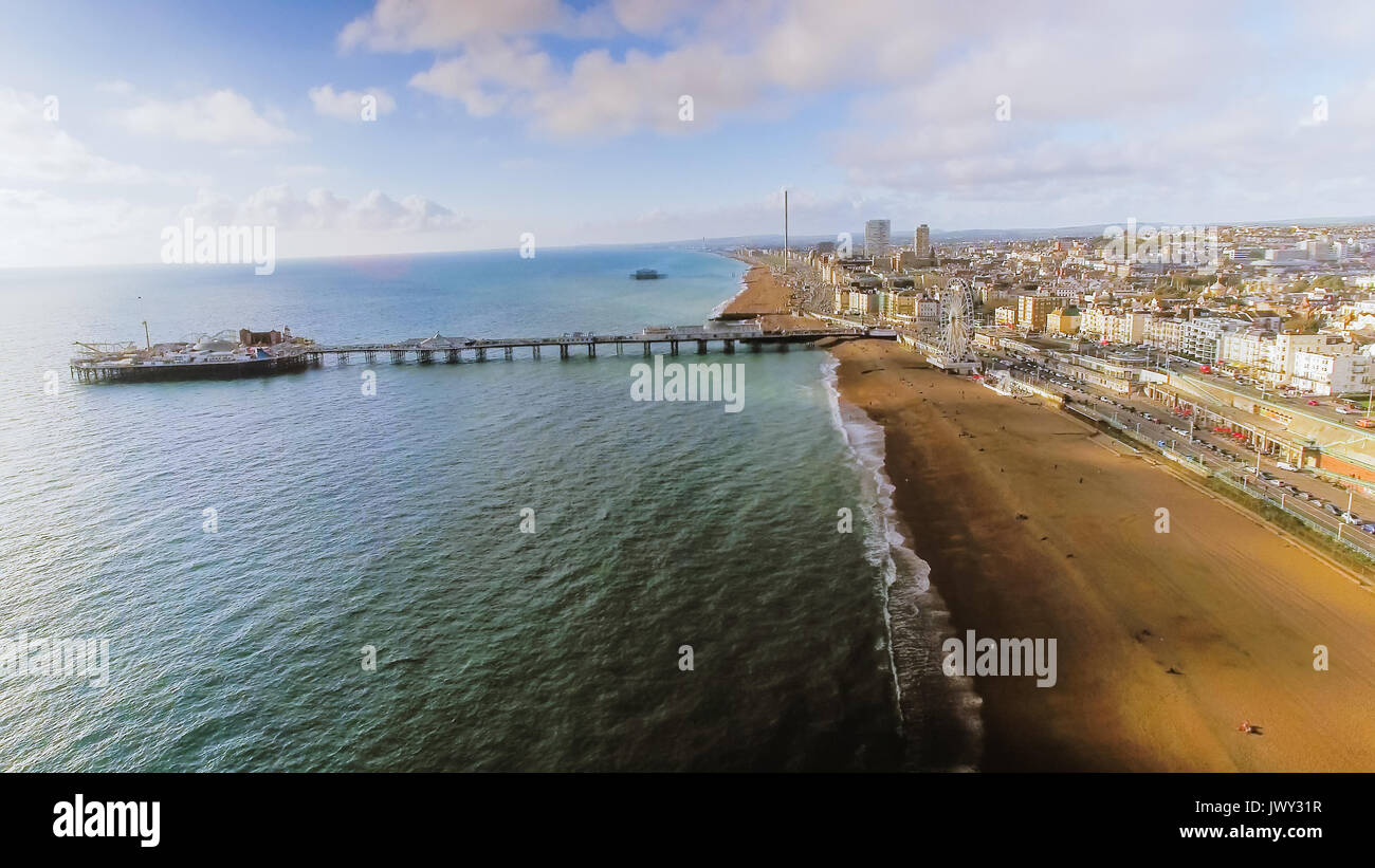 Aerial View Image of Brighton Pier with Seaside and Beach Coastline on a Sunny Day at East Sussex, England, UK - Stock Image
