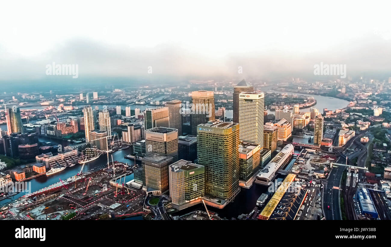 Aerial Image Photo of London City Financial District Skyscrapers in Canary Wharf Helicopter Flight View with Sunrise Stock Photo