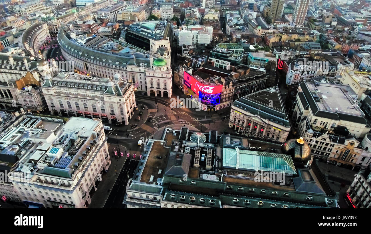 Aerial View Photo of Iconic Landmark Piccadilly Circus Commercial Signs feat. Regent Street and Soho in London City Town Center in England UK - Stock Image
