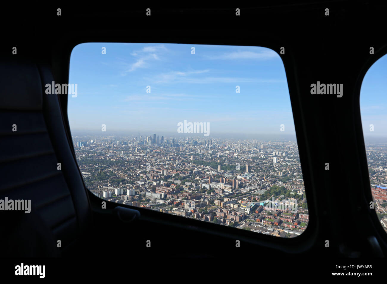 aerial view of the London skyline through a helicopter window, London, UK - Stock Image