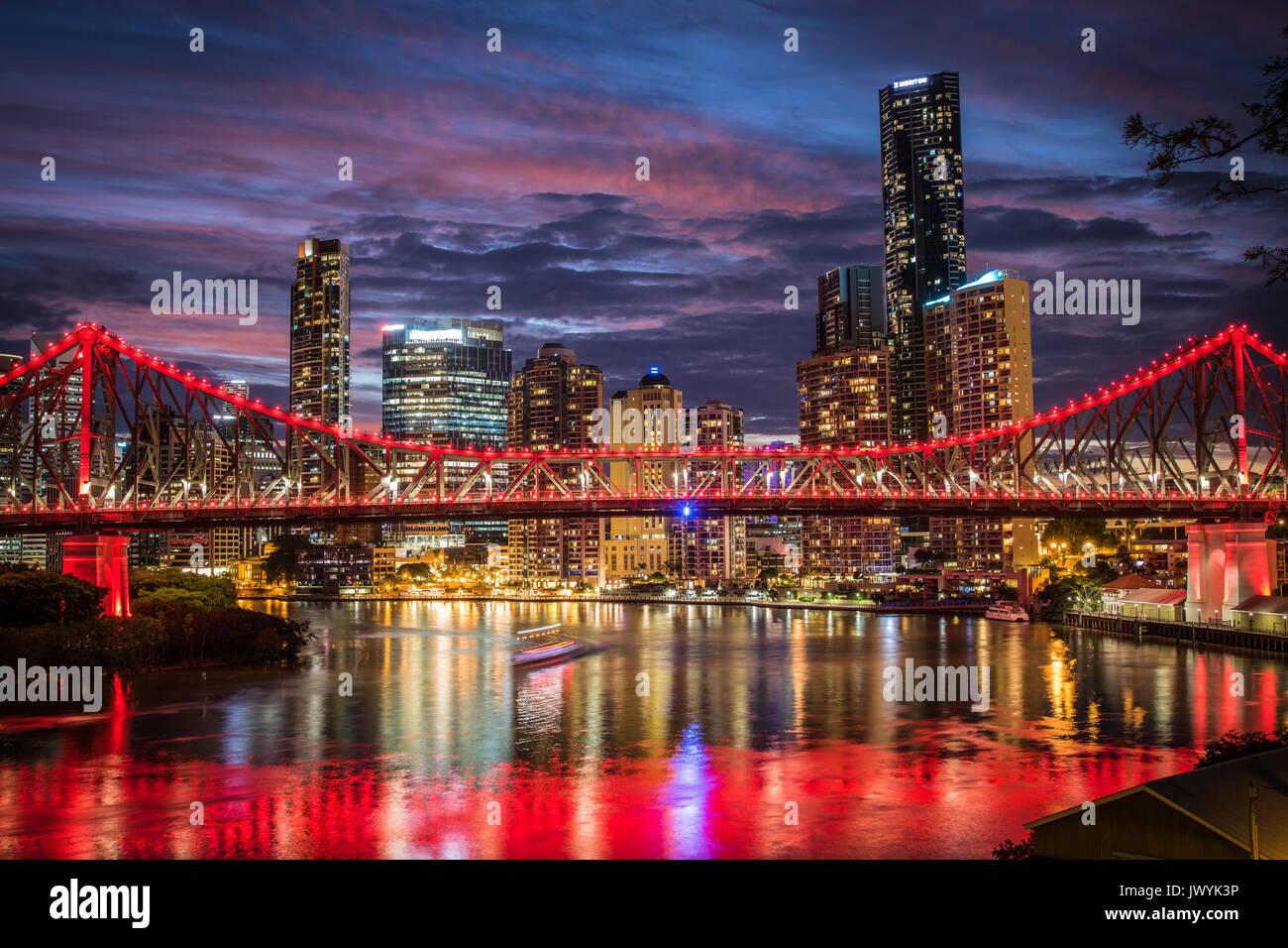 Storey bridge at sunset against the Brisbane cityscape - Stock Image
