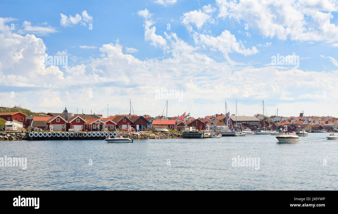 Mollösound harbour on the west coast archipelago of Sweden filled with boats and activity during summer  Model Release: No.  Property Release: No. - Stock Image