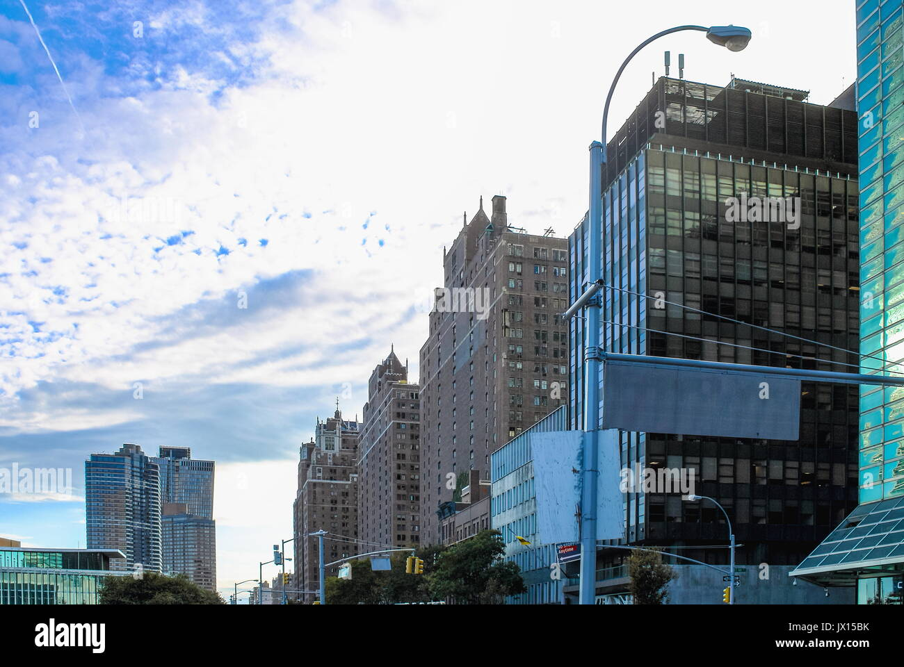 New York, USA - 26 September 2016: Buildings lining First Avenue looking toward lower Manhattan from 44th Street Stock Photo