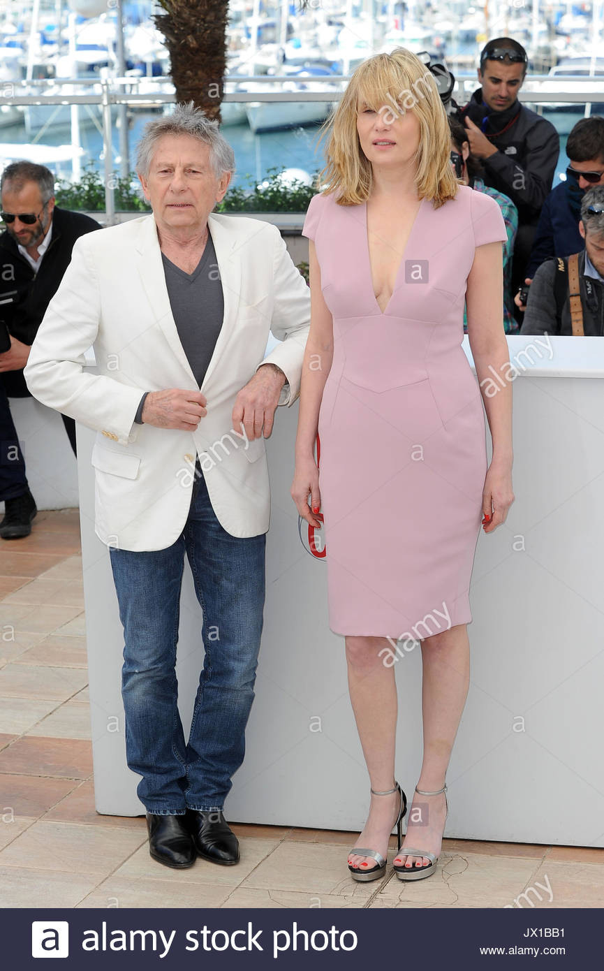 Emmanuelle Seigner, Roman Polanski. Director Roman Polanski and actors Emmanuelle  Seigner and Mathieu Amalric attending the photocall for 'La Venus A La ...