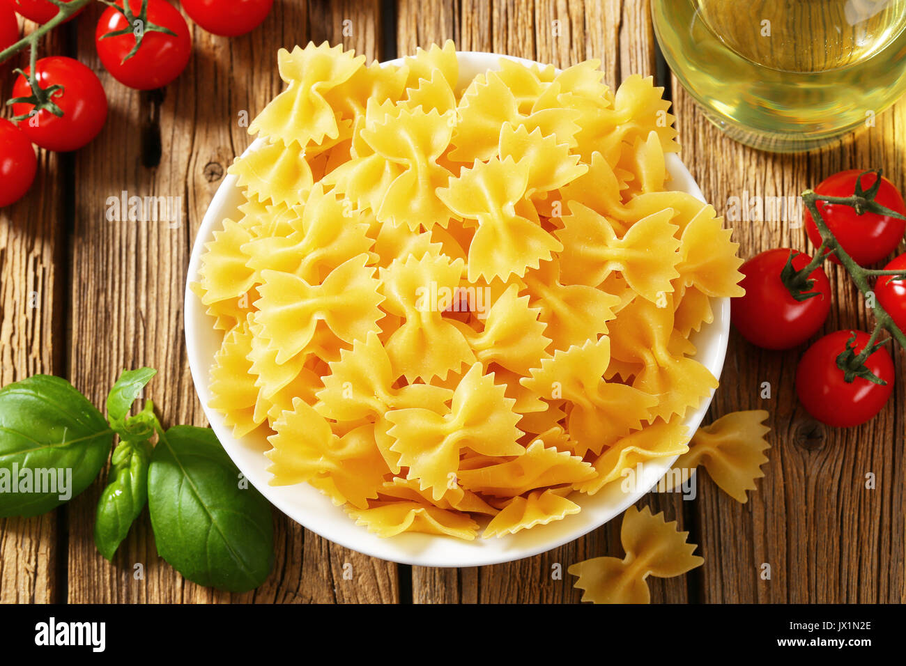 Uncooked bow tie pasta in bowl - Stock Image