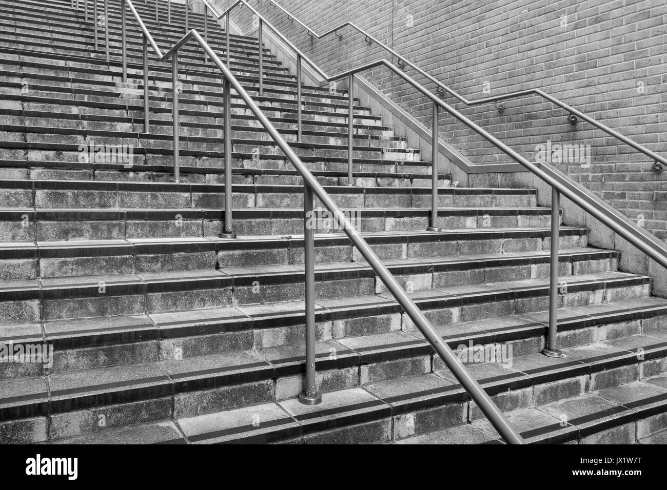 Concrete flight of steps with steel handrails - metaphor