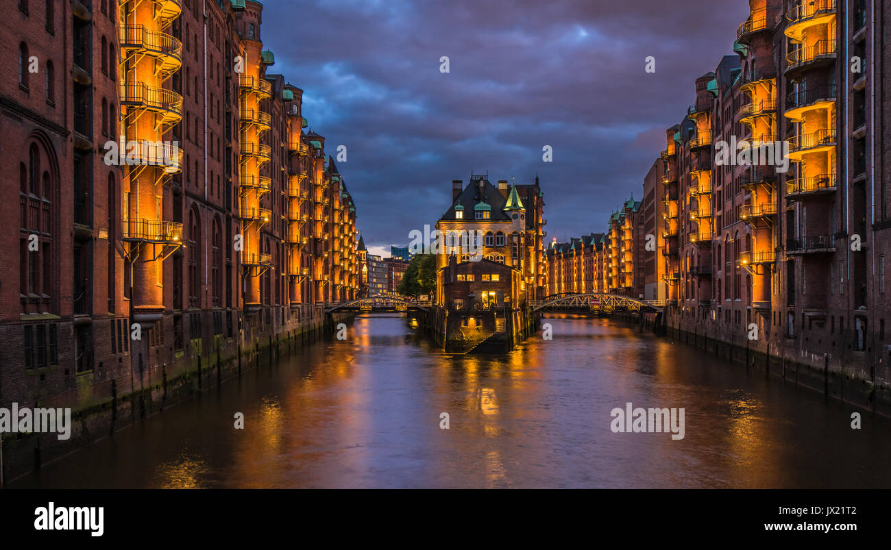 Water castle in old Speicherstadt or Warehouse district, Hamburg, Germany - Stock Image