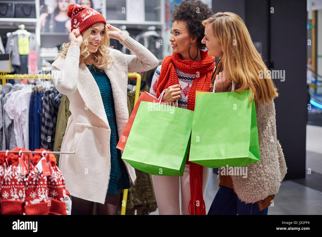 Friends helping with Christmas shopping - Stock Image