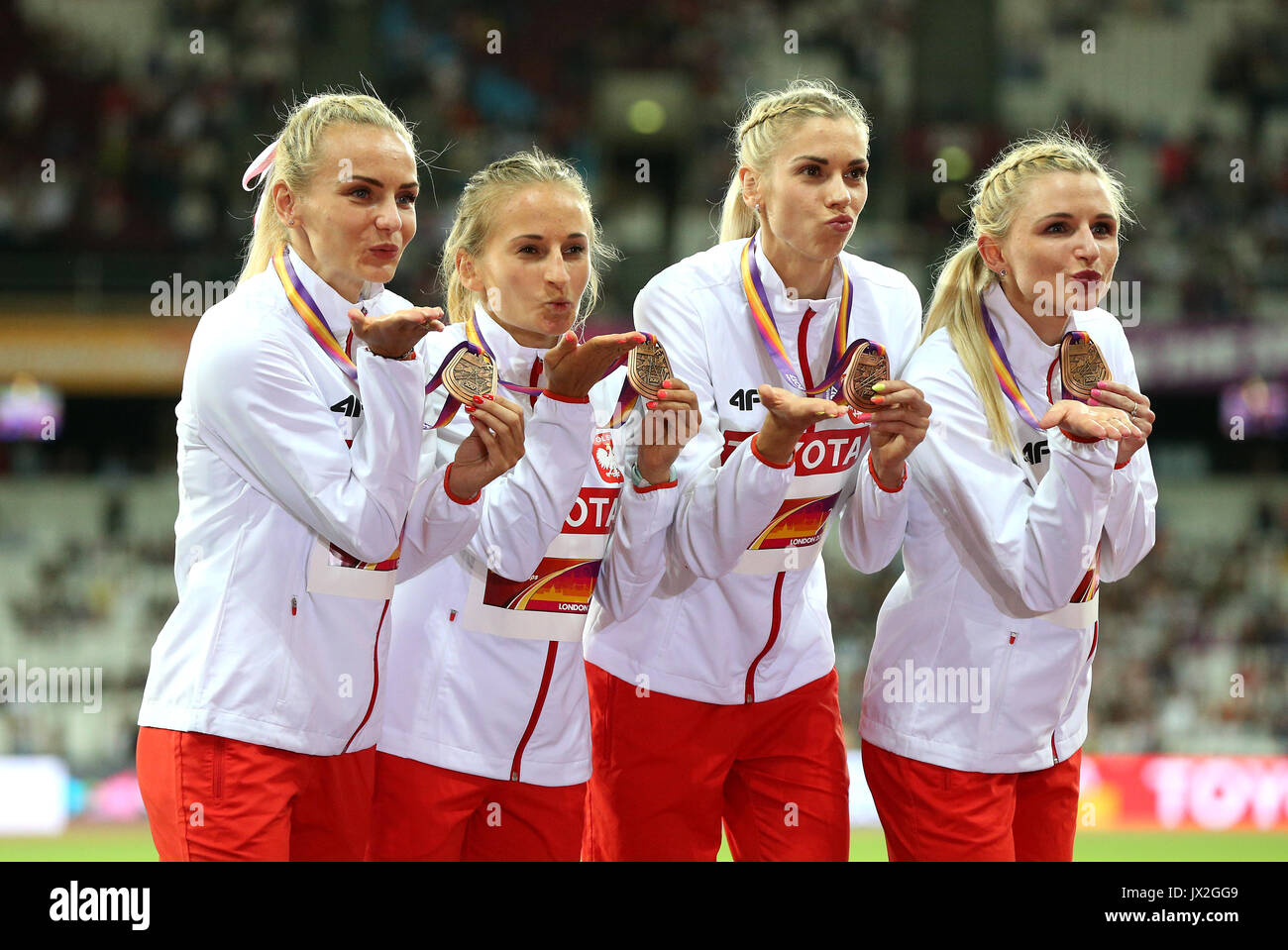 Poland Women's 4x400m relay final team (left to right) Justyna Swiety, Malgorzata Holub, Iga Baumgart and Alekandra Gaworska with their bronze medals during day ten of the 2017 IAAF World Championships at the London Stadium. PRESS ASSOCIATION Photo. Picture date: Sunday August 13, 2017. See PA story ATHLETICS World. Photo credit should read: Jonathan Brady/PA Wire. RESTRICTIONS: Editorial use only. No transmission of sound or moving images and no video simulation. - Stock Image