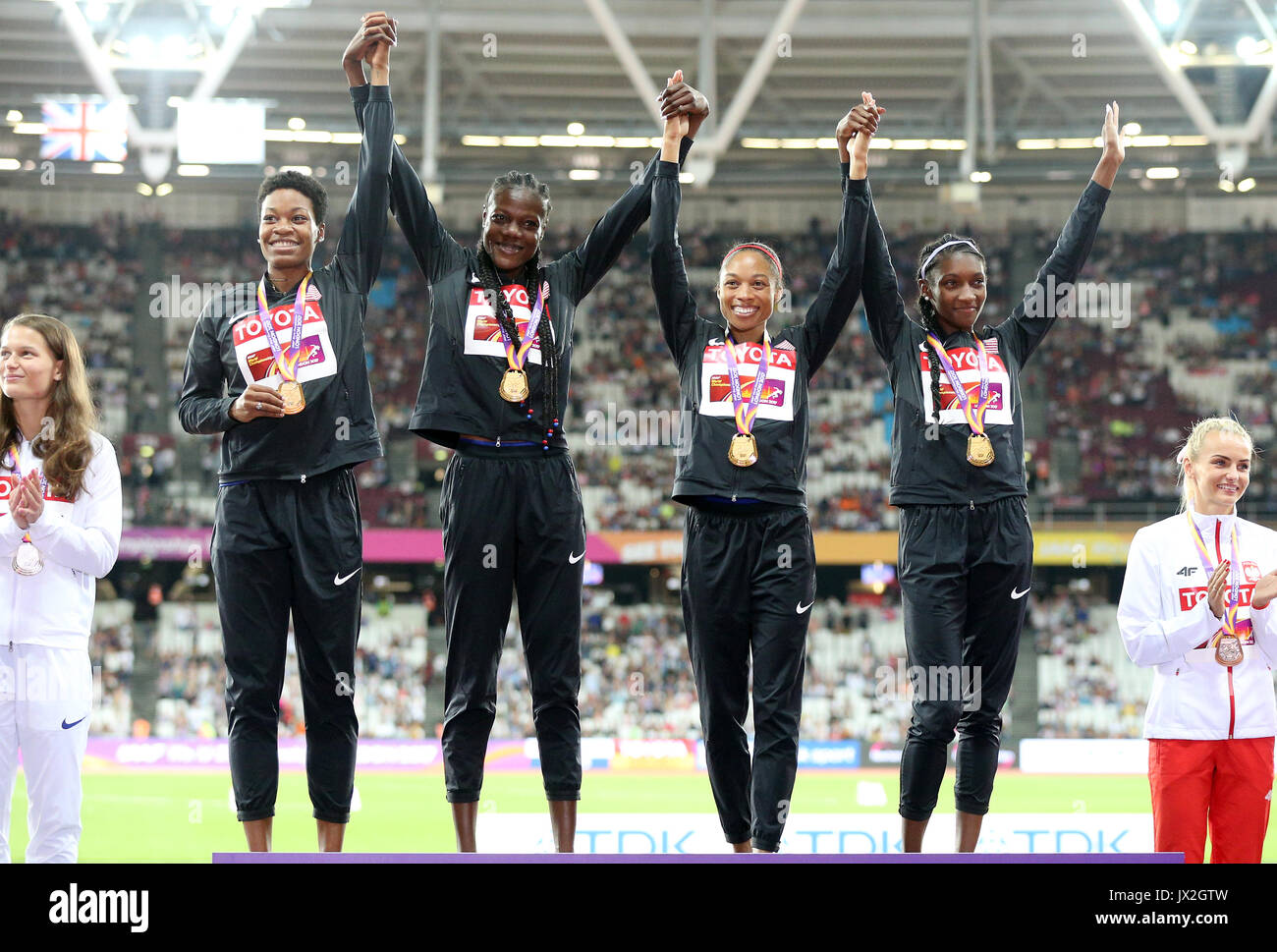 USA's 4x400m Women's Relay Team (left to right) Quanera Hayes, Allyson Felix, Shakima Wimbley and Phyllis Francis on the podium with their gold medals during day ten of the 2017 IAAF World Championships at the London Stadium. PRESS ASSOCIATION Photo. Picture date: Sunday August 13, 2017. See PA story ATHLETICS World. Photo credit should read: Jonathan Brady/PA Wire. RESTRICTIONS: Editorial use only. No transmission of sound or moving images and no video simulation. - Stock Image