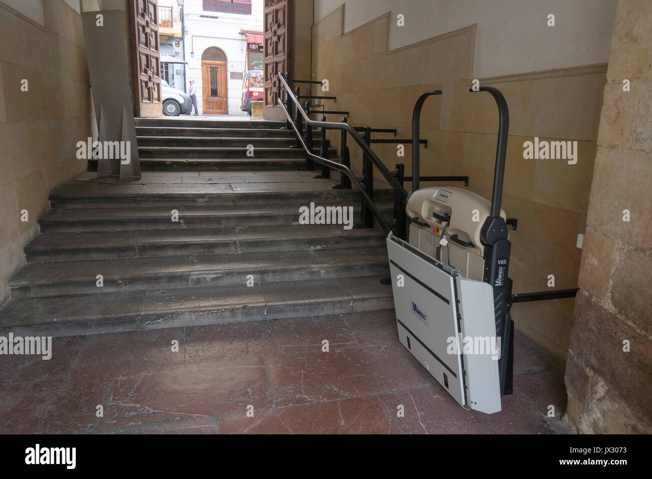 wheelchair stair lift. An Inclined Stairlift, Wheelchair Mobility Lift, Stair For Access Up And Down Some Old Stairs From A Courtyard To Main Street. Lift I