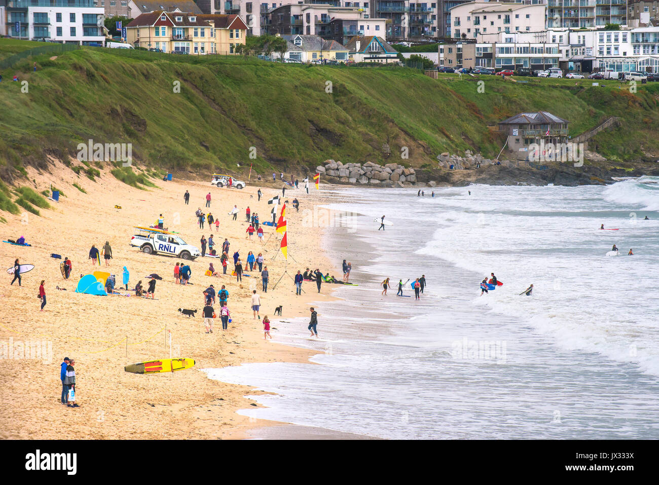 Holidaymakers enjoying themselves on Fistral Beach in Newquay, Cornwall. Stock Photo