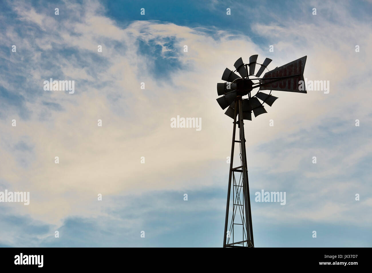Wind pump Silhouette  used for irrigation Hawkes Bay - Stock Image
