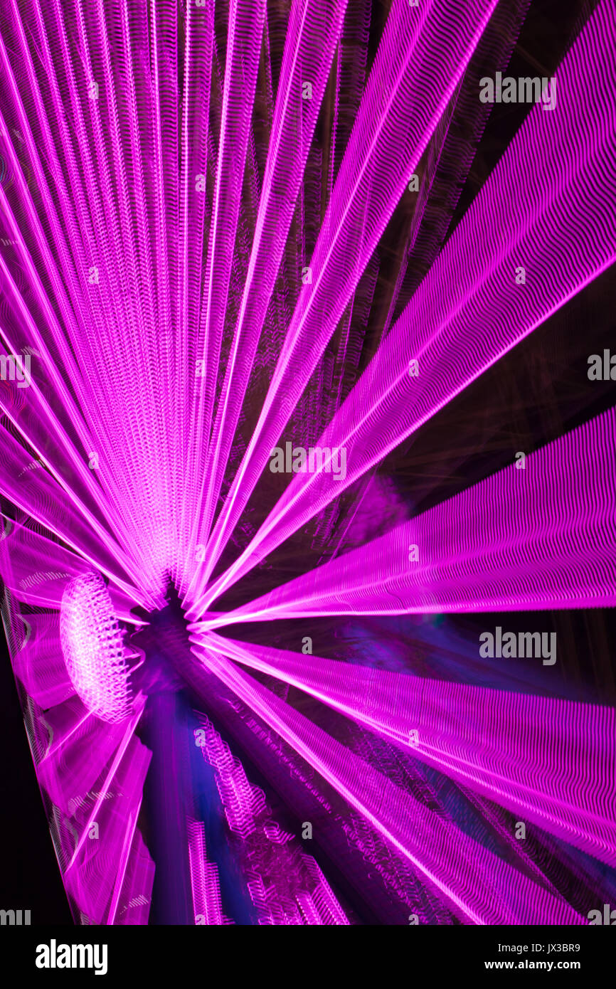 Abstract lights with motion blur (from a ferris wheel) - Stock Image