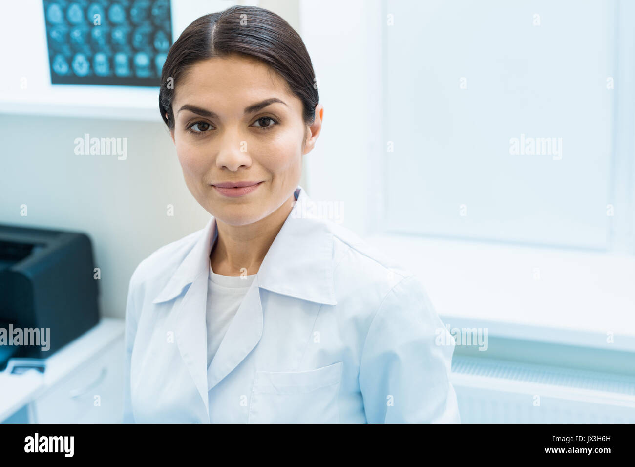 Portrait of a beautiful dark-haired female nurse - Stock Image