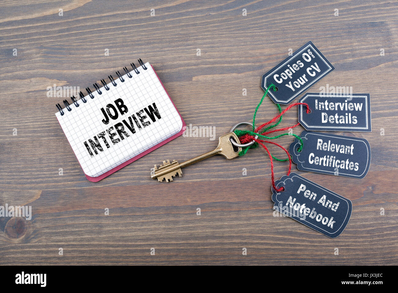 Job interview preparation concept. The key to success on a wooden office desk. - Stock Image