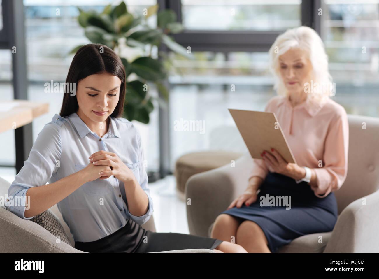 Nice woman feeling nervous - Stock Image