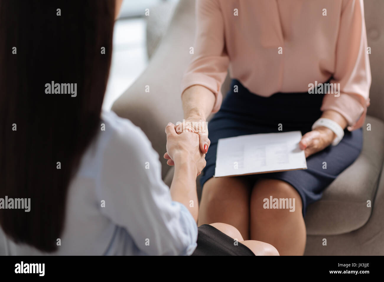 Close up of a friendly handshake - Stock Image