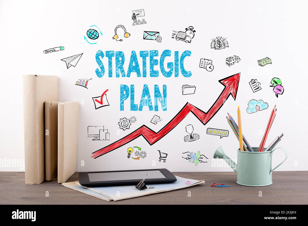 Strategic Plan. Books and stationery on a wooden office desk. - Stock Image