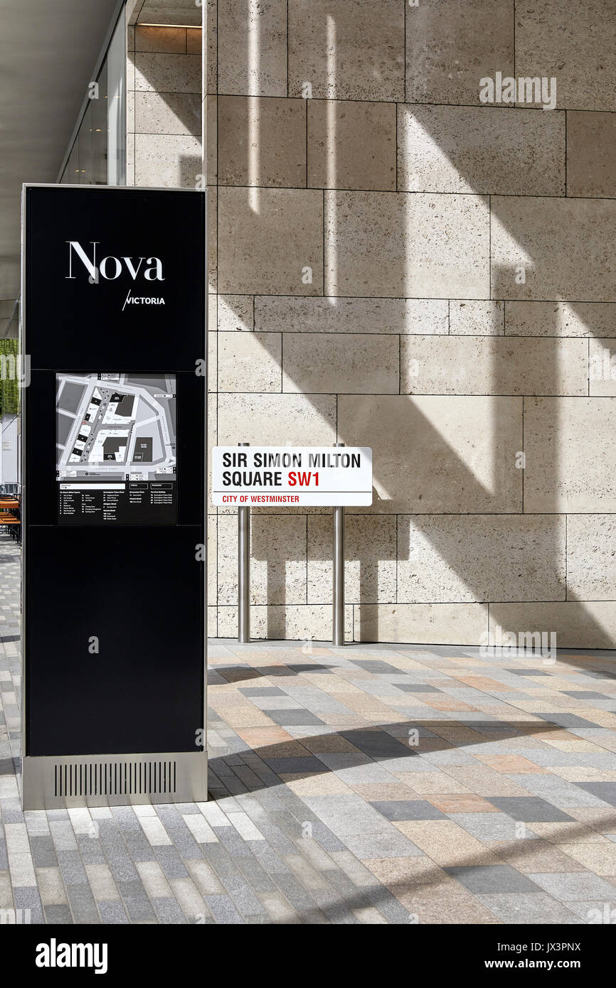 Light and shade across the Portland stone facade and signage. The Nova Building, Westminster, United Kingdom. Architect: PLP Architecture / Benson & F - Stock Image