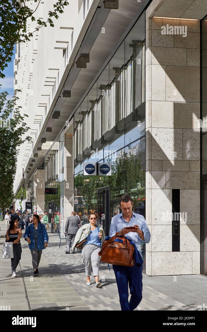 The Portland external stone facade with shoppers walking along the street. The Nova Building, Westminster, United Kingdom. Architect: PLP Architecture - Stock Image