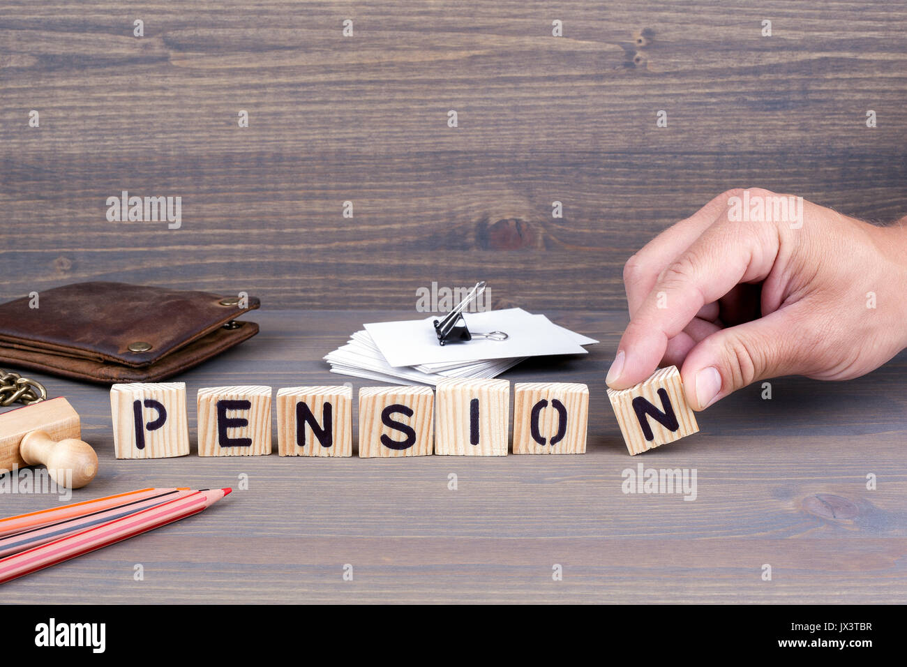 pension concept.Wooden letters on dark background. Office desk Stock Photo