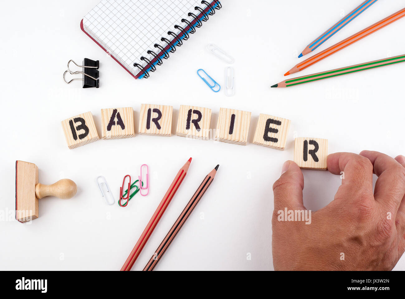 Barrier concept. Wooden letters on a white background. - Stock Image